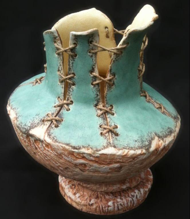 Ceramic pot stitched