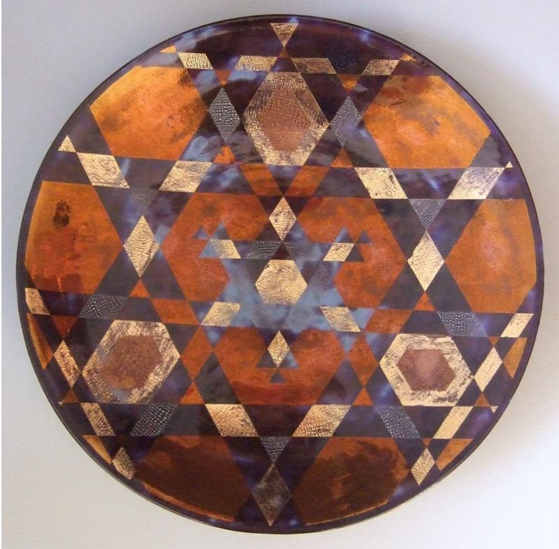 Large glazed dish lustre decoration