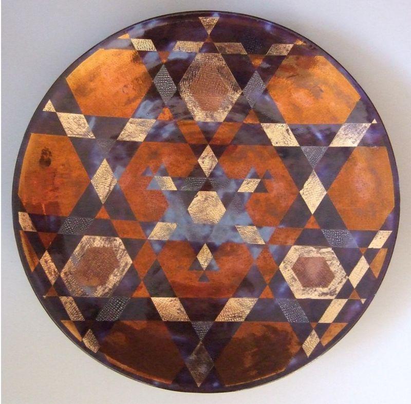 Large glazed dish lustre decoration